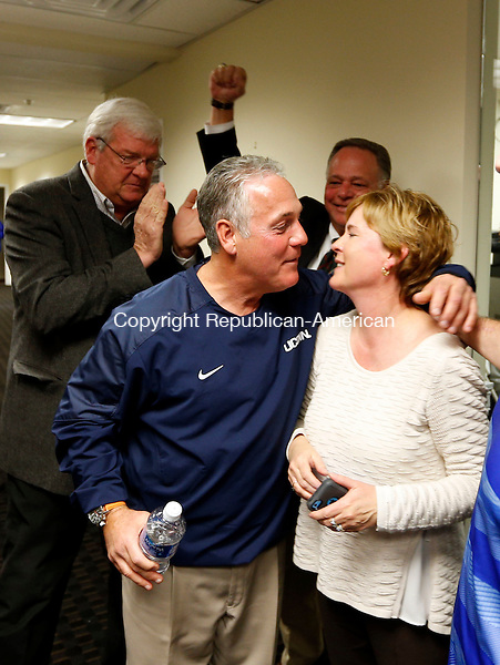Waterbury, CT- 08 November 2016-110816CM11-   State Rep. Candidate Jeffrey Berger, D-73rd, kisses his wife Noreen, after results come in at the Democratic headquarters on Bank Street in Waterbury on Tuesday. Berger defeated Republican challenger, Steve Giacomi.   Christopher Massa Republican-American