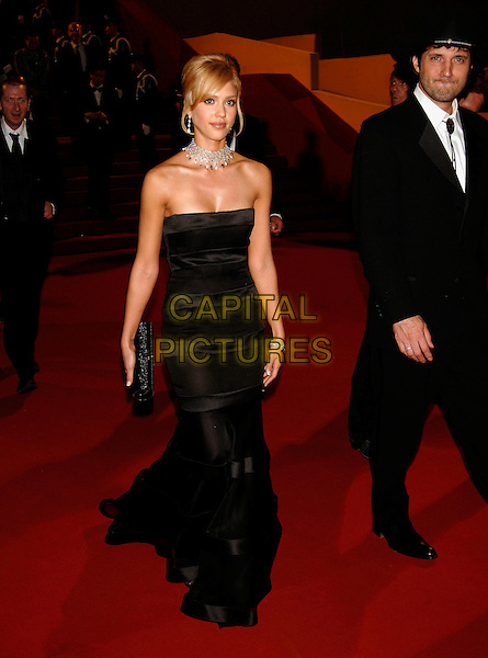 "JESSICA ALBA & ROBERT RODRIGUEZ.Depart ""Sin City"" Screening,.during the 58th International Cannes Film Festival, Cannes, France, May 18th 2005..full length black strapless dress diamond necklace choker earrings clutch bag cowboy hat.Ref: PL.www.capitalpictures.com.sales@capitalpictures.com.©Phil Loftus/Capital Pictures"