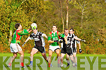 Cieran Granfiels and Padraig King St Michael's Foilmore and Ardfert's  Brian Moloney and Brian O'Sullivan in action during their Senior County Championship relegation play off in Listry on Saturday..