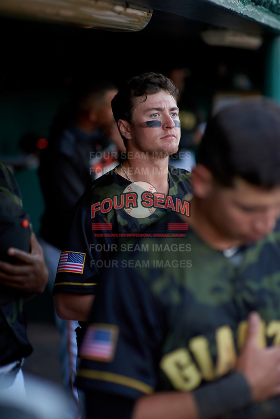 "San Jose Giants right fielder Logan Baldwin (1) in the dugout during the playing of ""God Bless America"" during a California League game against the Visalia Rawhide on April 13, 2019 at San Jose Municipal Stadium in San Jose, California. Visalia defeated San Jose 4-2. (Zachary Lucy/Four Seam Images)"