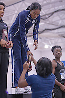 Coach Ailene Smith presents the 1st place trophy in the 60 meters to Anna-Kay James? who accepts thre trophy in place of Latoya King who was injured in winning the race.