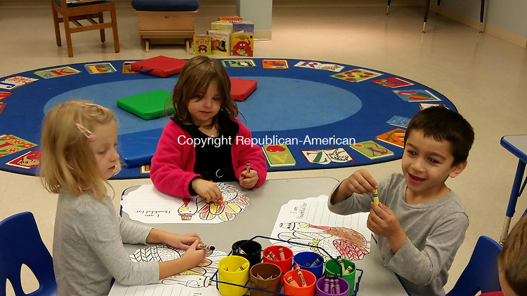 SOUTHBURY, CT: 16 Nov. 2015:111615BB01: SOUTHBURY ---- Kindergarteners enjoyed a story time with Joan Stokes, head of children's services at Southbury Public Library, Monday. Then they did a craft, coloring a turkey and jotting down a list of things they're thankful for. Coloring, from left, is Amanda Jose, 5, of Middlebury, Katherine Salsbury, 5, of Middlebury and Alejandro Alvarado, 5, of Southbury. Bill Bittar Republican-American