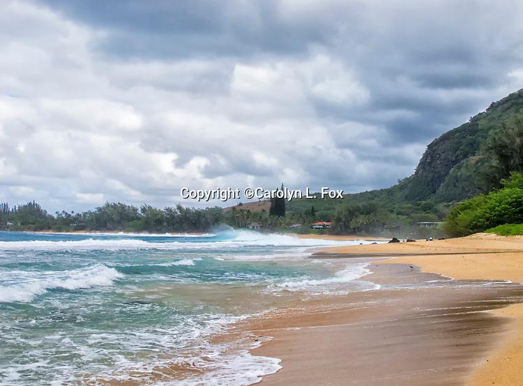 Waves crash against the shore on Kauai, Hawaii.