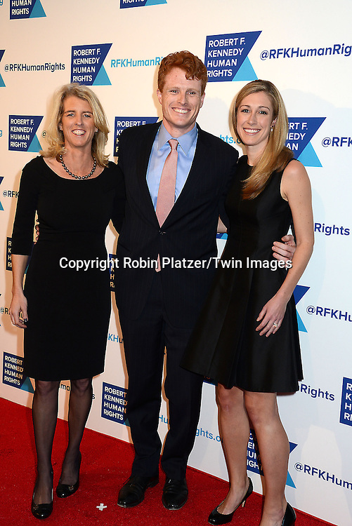 Rory Kennedy, Joe Kennedy, III and wife attend the Robert F Kennedy Center for Justice &amp; Human Rights  Ripple of Hope Award on December 16, 2014 at the New York Hilton in New York City, New York, USA. <br /> <br /> photo by Robin Platzer/Twin Images<br />  <br /> phone number 212-935-0770