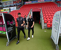 Lincoln City's Ellis Chapman, left, and Joshua Woodcock on arrival at Doncaster Rovers<br /> <br /> Photographer Andrew Vaughan/CameraSport<br /> <br /> EFL Leasing.com Trophy - Northern Section - Group H - Doncaster Rovers v Lincoln City - Tuesday 3rd September 2019 - Keepmoat Stadium - Doncaster<br />  <br /> World Copyright © 2018 CameraSport. All rights reserved. 43 Linden Ave. Countesthorpe. Leicester. England. LE8 5PG - Tel: +44 (0) 116 277 4147 - admin@camerasport.com - www.camerasport.com