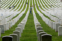 NEW YORK, NY - MAY 25: A man wearing a face mask walks among the graves of American soldiers at the Cypress Hill Military Cemetery on May 25, 2020 in Brooklyn, NY. Memorial Day is an American holiday that commemorates the men and women who died while serving in the United States Army. Today this date is celebrated during the Covid-19 pandemic that has caused thousands of deaths in the United States and around the world.  (Photo by Pablo Monsalve / VIEWpress)