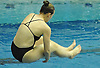 Caroline Tighe of East Meadow soars through the air during the Nassau County girls' diving championship and state qualifier at Nassau Aquatic Center on Wednesday, November 4, 2015. She finished in second place with a total score of 435.00.<br /> <br /> James Escher