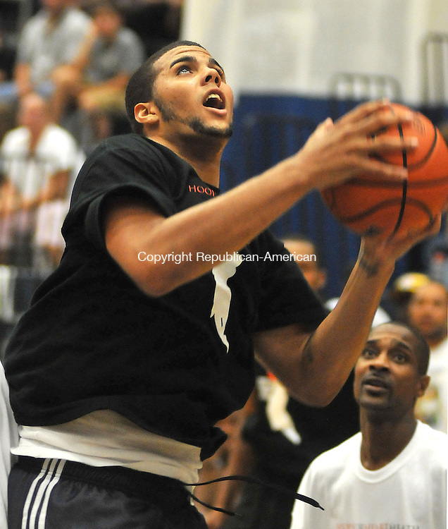 WATERBURY, CT, 23 SEPTEMBER 2011-092311JS06--Future NBA player for the New Jeresy Nets and former Torrington High School standout Jordan Williams pulls down a rebound during the Ryan Gomes All-Stars basketball game with the New York City Street Ballers Friday at Crosby High School in Waterbury. The event was held as  a fund raiser for Hoops for Heart Health, the Ryan Gomes Foundation charity that donates heart defibrillators to schools and gymnasiums around the country. The second will support a college fund for the child of Timothy &quot;T.J.&quot; Mathis was shot and killed in New Haven earlier this month. Mathis was a former Hamden High basketball star who later played at Morgan State University and Mercyhurst College. The 25-year-old had become a close friend to Gomes through their shared love of basketball. The two were teammates in summer league tournaments, and often played together right here at the North End Rec Center.<br /> Jim Shannon Republican-American