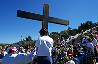 Priest leading prayer on a Good Friday procession outside Notre Dame de la Garde basilica, Marseille, France.