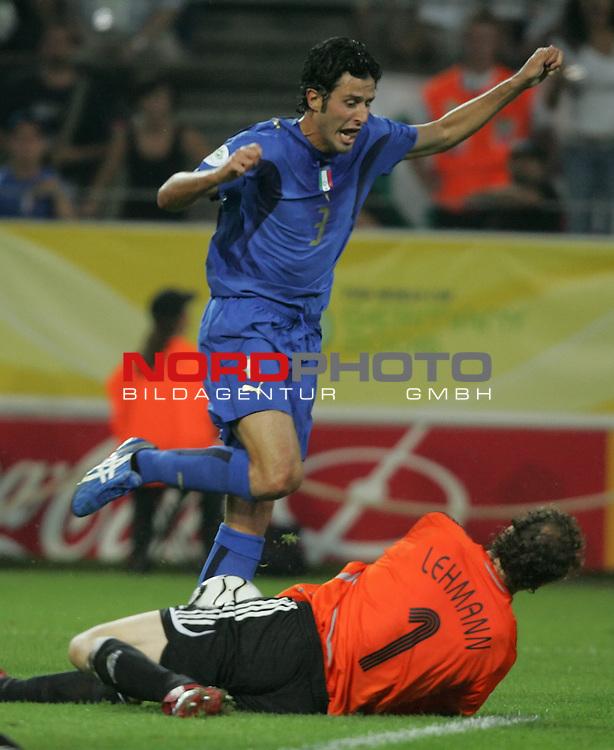 FIFA WM 2006 -  Semi Finals / Halbfinale<br /> Play    #61 (04-Juli) - Deutschland - Italien 0:2 n.V.<br /> <br /> Torwart Jens Lehmann (am Boden) von Deutschland kommt vor Fabio Grosso von Italien an den Ball.<br /> <br /> Foto &copy; nordphoto