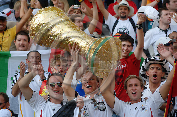 "BERLIN - GERMANY 20. JUNE 2006 - Olympiastadion -- German fans with a copy of the FIFA-trophy -- PHOTO: GORM K. GAARE / EUP & IMAGES..This image is delivered according to terms set out in ""Terms - Prices & Terms"". (Please see www.eup-images.com for more details)"
