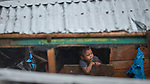 An indigenous boy sits in a boat on the Javari River in Atalaia do Norte in Brazil's Amazon region.