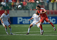 06 June 2009: Toronto FC forward Pablo Vitti #8 heads the ball between Los Angeles Galaxy midfielder Josh Tudela #19 and Los Angeles Galaxy midfielder Dema Kovalenko #8 during  MLS action at BMO Field Toronto in a game between LA Galaxy and Toronto FC. .The Galaxy  won 2-1.