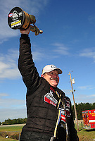 Mar. 12, 2012; Gainesville, FL, USA; NHRA pro stock driver Mike Edwards celebrates after winning the Gatornationals at Auto Plus Raceway at Gainesville. The race is being completed on Monday after rain on Sunday. Mandatory Credit: Mark J. Rebilas-