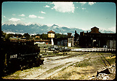 View of Salida yards looking west. D&amp;RGW #1137 standard gauge engine to left, turntable, roundhouse, engine house, tank, coaling tower.<br /> D&amp;RGW  Salida, CO