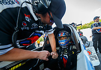 Jun 10, 2017; Englishtown , NJ, USA; A crew member straps in NHRA top fuel driver Antron Brown during qualifying for the Summernationals at Old Bridge Township Raceway Park. Mandatory Credit: Mark J. Rebilas-USA TODAY Sports