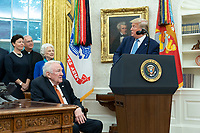 United States President Donald J. Trump, right, makes remarks as he presents the Presidential Medal of Freedom to former US Attorney General Edwin Meese, left, at the White House in Washington, DC, October 8, 2019. Meese served from 1985 to 1988 under US President Ronald Reagan. Credit: Chris Kleponis / Pool via CNP /MediaPunch