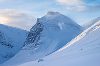1662 meter Tolpagorni - Duolbagorni rises above Ladtjovagge in Winter viewed from near Kebnekaise Fjällstation, Lappland, Sweden