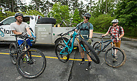 Philip Zach (from left), Grant Stahla, both from Lincoln, Neb., and Jared McDaniel of Siloam Springs gear up for a mountain bike ride Saturday, May 16, 2020, at the Hobbs State Park - Conservation Area visitor center near Rogers. Go to nwaonline.com/200517Daily/ to see more photos.<br /> (NWA Democrat-Gazette/Ben Goff)