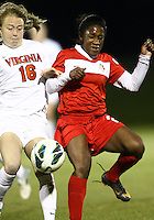 BOYDS, MARYLAND - April 06, 2013:  Jasmyne Spencer (20) of The Washington Spirit clashes with Emily Sonnett (16) of the University of Virginia women's soccer team in a NWSL (National Women's Soccer League) pre season exhibition game at Maryland Soccerplex in Boyds, Maryland on April 06. Virginia won 6-3.