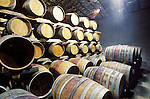 Stacked oak barrels in a small winery cellar, Amador County, Calif.