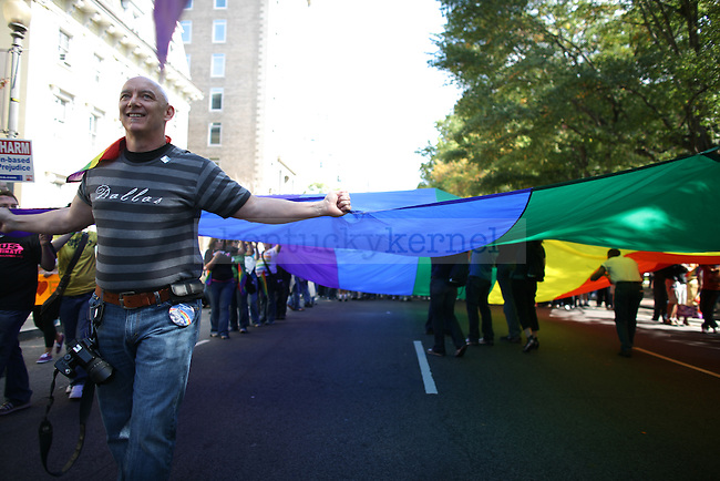 Greg Sharp helps hold an extremely large gay pride flag during the National Equality March to fight for equal rights for the LGBT community in Washington, D.C. on Sunday, Oct. 11, 2009. Photo by Adam Wolffbrandt | Staff