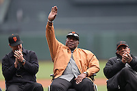SAN FRANCISCO, CA - APRIL 6:  San Francisco Giants legend Willie McCovey waves to the crowd while seating between Jeff Kent (L) and Willie Mays during a ceremony honoring Buster Posey for winning the 2012 National League MVP before the Giants game against the St. Louis Cardinals at AT&T Park on April 6, 2013 in San Francisco, California. Photo by Brad Mangin