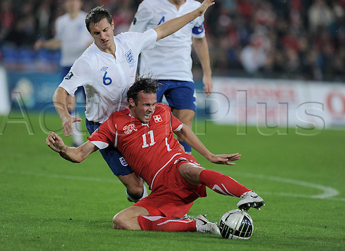 07.09.2010 England continued their impressive start to the Euro 2012 qualifying campaign with a convincing 3-1 victory over Switzerland in Basel. Picture shows Marco Streller right Switzerland and Phil Jagielka England.
