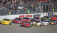 A pack of cars races down the frontstretch during the Pop Secret 400 NASCAR Winston Cup race at Rockingham, NC on Sunday, November 9, 2003. (Photo by Brian Cleary)