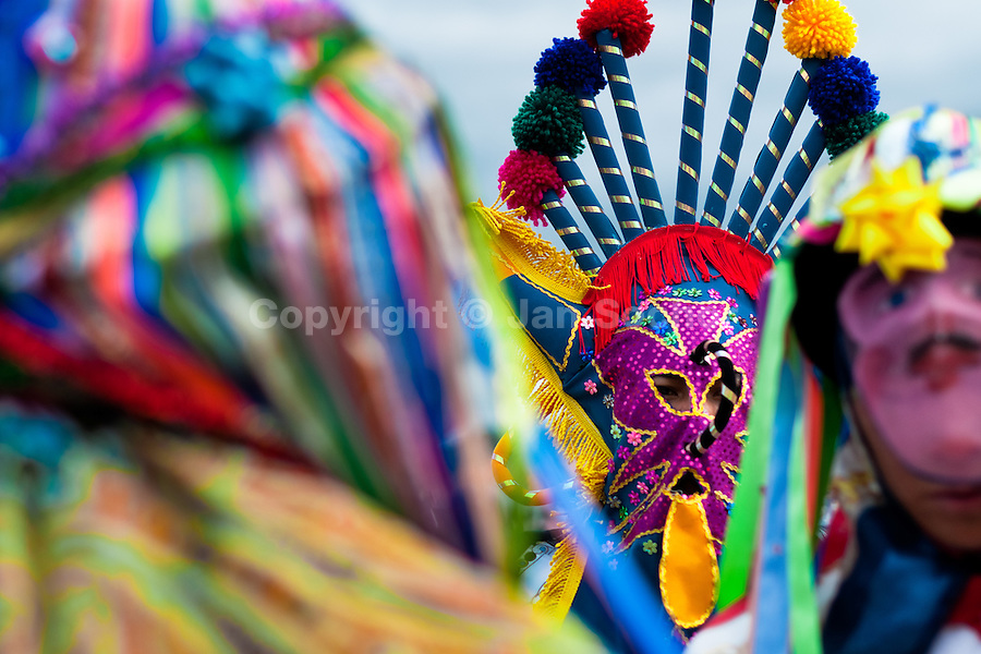 """A man dancer in a colorful costume dances during the celebration of Inti Raymi in Pichincha province, Ecuador, 26 June 2010. Inti Raymi, """"Festival of the Sun"""" in Quechua language, is an ancient spiritual ceremony held in the Indian regions of the Andes, mainly in Ecuador and Peru. The lively celebration, set by the winter solstice, goes on for various days. The highland Indians, wearing beautiful costumes, dance, drink and sing with no rest. Colorful processions in honor of the God Inti (Sun) pass through the mountain villages giving thanks for the harvest and expressing their deep relation to the Mother Earth (Pachamama)."""