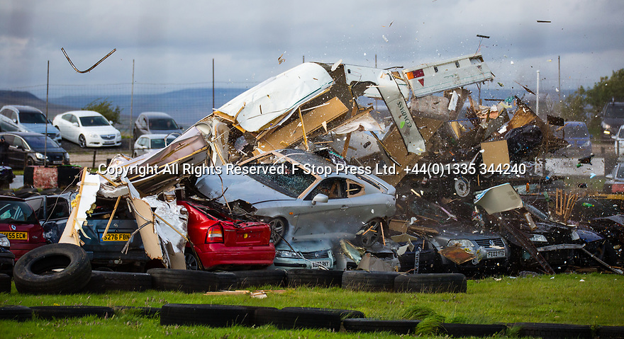 27/08/18<br /> <br /> After a bank holiday weekend where thousands of drivers  sat in traffic stuck behind caravans, a stunt driver drives his car up a ramp smashing through one of the offending caravans at the Buxton Raceway banger racing event near Buxton, Derbyshire.<br /> <br /> All Rights Reserved, F Stop Press Ltd. (0)1335 344240 +44 (0)7765 242650  www.fstoppress.com rod@fstoppress.com