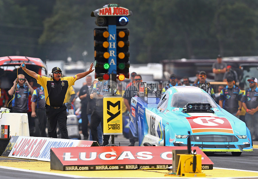 Aug 18, 2017; Brainerd, MN, USA; NHRA funny car driver Tim Wilkerson during qualifying for the Lucas Oil Nationals at Brainerd International Raceway. Mandatory Credit: Mark J. Rebilas-USA TODAY Sports