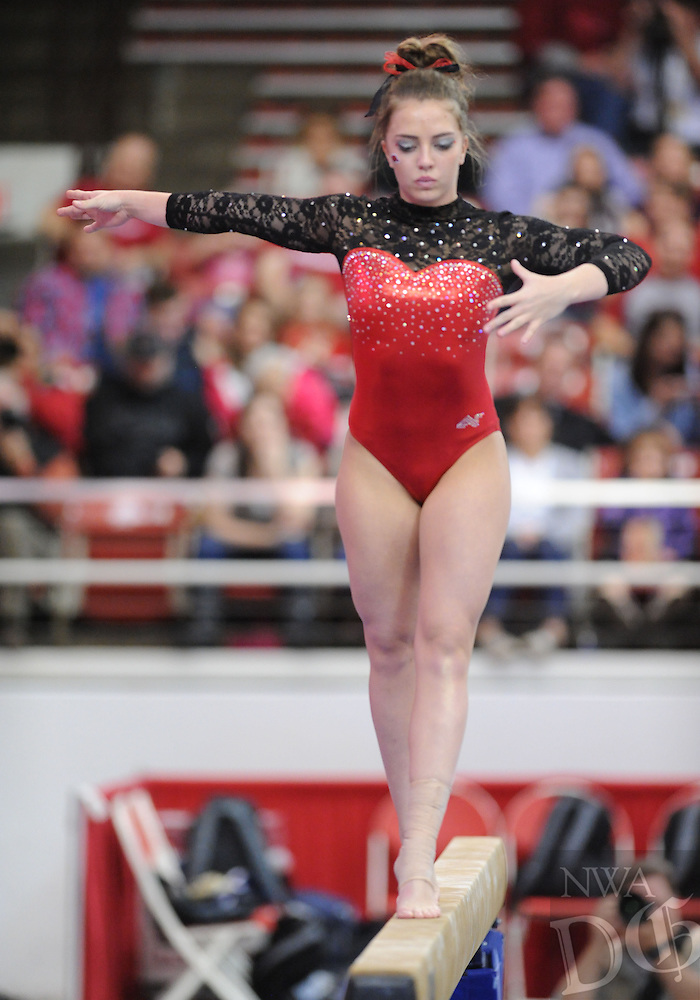 NWA Democrat-Gazette/ANDY SHUPE<br /> Arkansas&rsquo; Sydney McGlone competes Friday, March 11, 2016, in the beam rotation during the 11th-ranked Razorbacks&rsquo; meet with Utah State in Barnhill Arena in Fayetteville. Visit nwadg.com/photos to see more photographs from the meet.