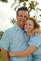 Portrait of a loving couple hugging near palm trees