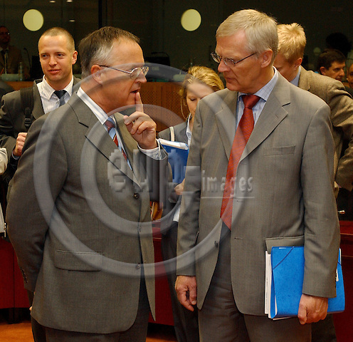Brussels-Belgium - May 11, 2004---Meeting of the ECOFIN Council at the 'Justus Lipsius', seat of the Council of the European Union in Brussels; here, Hans EICHEL (le), German Federal Minister for Finance, with Bo RINGHOLM (ri), Swedish Minister for Finance---Photo: Horst Wagner/eup-images