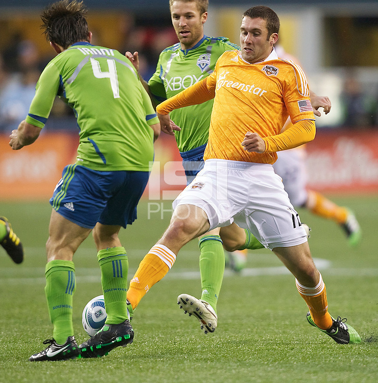 Houston Dynamo forward Will Bruin, right, tries to get the ball around Seattle Sounders FC defender Patrick Ianniduring play at Qwest Field in Seattle Friday March 25, 2011. The match ended in a 1-1 draw.