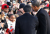 Sasha Obama (L), the younger daughter of United States President Barack Obama (R), greets President Hu Jintao of China (C) during a state arrival ceremony at the South Lawn of the White House, Wednesday, January 19, 2011 in Washington, DC. Hu and President Obama will hold a press conference at the White House later today. .Credit: Alex Wong / Pool via CNP