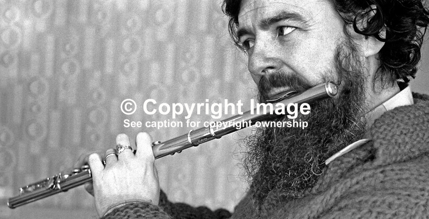 N Ireland-born virtuoso flautist James Galway enjoys an impromptu session in Belfast during a visit to his home city on 30th January1976. 197601300073d..Copyright Image from Victor Patterson, 54 Dorchester Park, Belfast, United Kingdom, UK...For my Terms and Conditions of Use go to http://www.victorpatterson.com/Victor_Patterson/Terms_%26_Conditions.html