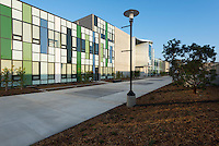 Mesa Community College Social & Behavioral Sciences Building, San Diego, 2014. Colorful building facade and wide, barrier-free walkways. Marian Marum, Landscape Architect.