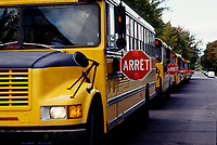 1997  File Photo - Montreal (qc) CANADA - Yellow school buses with stop sing (arret in French)