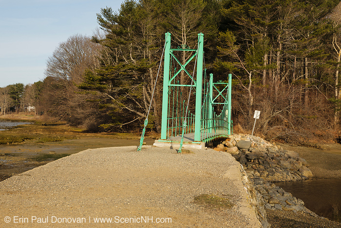 Wiggly Bridge during the spring  months. Located in York, Maine  USA,  which is on the New England seacoast.  .Notes:  This small foot bridge was built in the 1930s and wiggles while you walk across it..