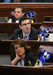 Nevada Assembly members, from top, Elliot Anderson, Wes Duncan and Teresa Benitez-Thompson work on the Assembly floor at the Legislative Building in Carson City, Nev., on Sunday, June 2, 2013. <br /> Photo by Cathleen Allison