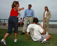 Lieutenant Governor John Garamendi (center) and Angela Howe of Surfrider speak to a couple on vacation from Paris at the base of Newport Avenue in Ocean Beach, Friday, July 25 2008.  Garamendi and Howe were in OB to hold a press conference to speak about California Marine Debris and a report that will be published soon.