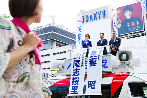 (L to R) The Democratic Party of Japan's policy chief Shiori Yamao and Acting President Akira Nagatsuma, speak during a campaign event for July's House of Councillors elections in Shinjuku on June 10, 2016, Tokyo, Japan. DPJ Acting President Nagatsuma came to support Yamao's election campaign. Yamao has highlighted a shortage of nurseries as a key issue. (Photo by Rodrigo Reyes Marin/AFLO)