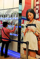A customer look at a range of mobile phones in Hong Kong..
