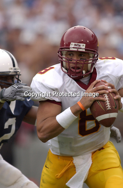 27 September 2003:  Asad Abdul-Khaliq (8) scrambles away from Penn States Deryck Toles (2).  Minnesota defeated Penn State 20-14  at Beaver Stadium in State College, PA..Mandatory Credit: Randy Litzinger..