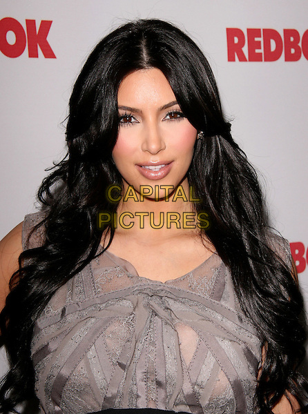 KIM KARDASHIAN.at REDBOOK's first-ever family issue celebration held at The Sunset Tower Hotel in West Hollywood, California, USA, April 11th 2011..portrait headshot beauty  grey gray top                                                                                 .CAP/RKE/DVS.©DVS/RockinExposures/Capital Pictures.