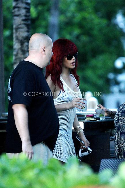 WWW.ACEPIXS.COM . . . . .  ....July 13 2011, Miami Beach....Singer Rihanna seen at a hotel in South Beach on July 13 2011 in Miami....Please byline: NANCY RIVERA- ACEPIXS.COM.... *** ***..Ace Pictures, Inc:  ..Tel: 646 769 0430..e-mail: info@acepixs.com..web: http://www.acepixs.com