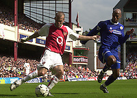 Premiership Football - Arsenal v Leicester City:.2003/04 Season - 15/05/2004  [Record breaking Season undefeated] .Fredrik Ljungberg, moving in from the wing to centre the ball is challenged by Jorden Stewart [right][Credit] Peter Spurrier Intersport Images