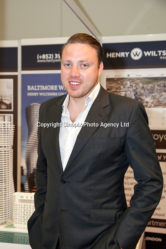 Adam Dockley, UK sales director of Henry Wiltshire at the Smart International Property Investment Expo at the Hong Kong Convention and Exhibition Centre in Hong Kong. <br /> 07-08 June, 2014<br /> <br /> Photo by Tim O'Rourke / Sinopix